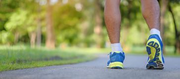 Young fitness man legs running in the park outdoor royalty free stock images