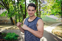Young fitness man prepares for boxing workout training Royalty Free Stock Photography