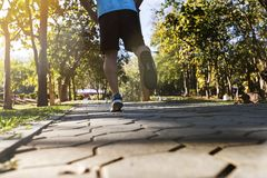 Young fitness man runner running on road Royalty Free Stock Photo