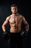 Young fitness man in studio Stock Images