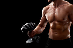 Young fitness man in studio. Ready for a challenge. Cropped closeup shot of a shirtless fitness man with perfect body working out holding a dumbbell Royalty Free Stock Image