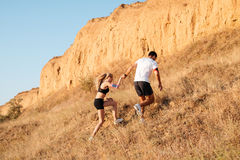 Young fitness man and woman doing jogging sport. Young fitness men and women doing jogging sport outdoors stock photography