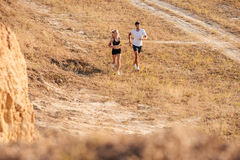 Young fitness man and woman doing jogging sport. Young fitness men and women doing jogging sport outdoors royalty free stock image