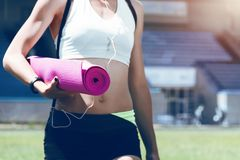 Young fitness muscle sporty runner girl / woman / female Royalty Free Stock Images