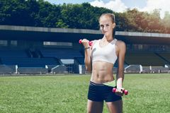 Young fitness muscle sporty runner girl / woman / female Royalty Free Stock Photo