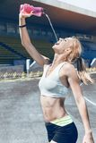 Young fitness muscle sporty runner girl / woman / female Stock Photo