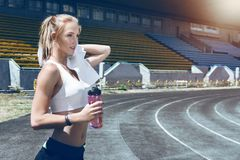 Young fitness muscle sporty runner girl / woman / female Stock Images