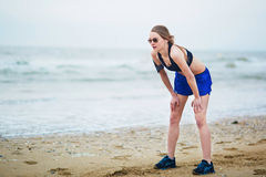 Young fitness running woman jogging on beach royalty free stock images