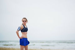 Young fitness running woman jogging on beach Stock Images