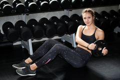 Free Young Fitness Sport Girl Doing Abdominal Exercises With Weight Barbell Plate In Gym.woman In Sportswear Workout Sit Ups Strengthen Stock Photo - 150149750