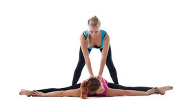 Young fitness trainer help for exercise yoga asana Stock Images