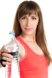 Young fitness woman with a bottle of water isolated on white background Stock Photography