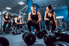 The young fitness woman and coach Royalty Free Stock Photography