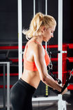 Young fitness woman demonstrate crossover exercises. The pectoral muscles, hard training with exercise-machine Cable Stock Photos