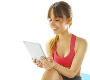 Young fitness woman with a digital tablet Stock Image