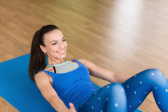 Young fitness woman doing abdominal exercises Royalty Free Stock Photo