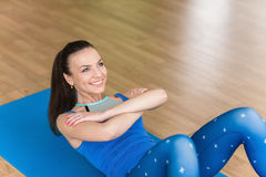 Young fitness woman doing abdominal exercises Stock Photos