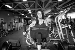 Young fitness woman doing cardio exercises at the gym running on a treadmill. Female runner training at the health club Royalty Free Stock Photo