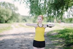 Young fitness woman doing exercise before run. Stock Photo