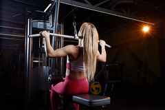 Young fitness woman doing exercises the major muscle groups in the gym. Strength training. Stock Photo