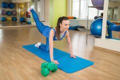 Young fitness woman doing leg exercises Stock Photography