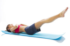 Young fitness woman doing pilates exercise Royalty Free Stock Photo