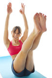 Young fitness woman doing pilates exercise. Beautiful fit woman doing exercise isolated Royalty Free Stock Image