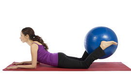 Young fitness woman doing pilates exercises with a pilates ball Stock Image