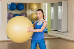 Young fitness woman doing slopes with fitball Royalty Free Stock Images