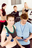 Young fitness woman doing spinning with instructor Royalty Free Stock Image