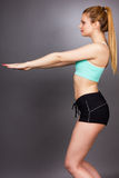 Young fitness woman doing squat exercises Royalty Free Stock Photography