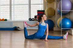 Young fitness woman doing stretching at the gym Royalty Free Stock Images