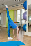 Young fitness woman doing stretching at the gym Royalty Free Stock Photo