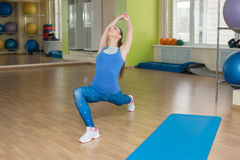 Young fitness woman doing stretching at the gym Stock Photo