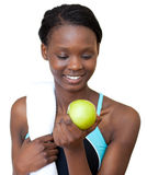 Young fitness woman eating an apple Royalty Free Stock Photography