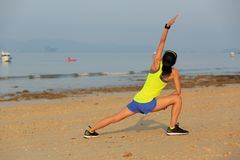 Young fitness woman exercise on beach. Healthy lifestyle young fitness woman exercise on beach Royalty Free Stock Image