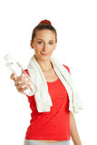 Young fitness woman giving bottle of water Stock Image