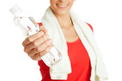 Young fitness woman giving bottle of water Royalty Free Stock Images