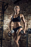 Young fitness woman in gym Stock Image