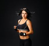 Young fitness woman in gym gloves Royalty Free Stock Images