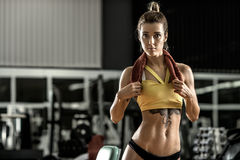 Young fitness woman in gym Stock Images