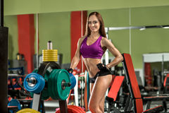 Young fitness woman in gym, smile Royalty Free Stock Image
