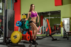 Young fitness woman in gym Stock Photos