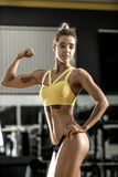 Young fitness woman in gym Royalty Free Stock Photos