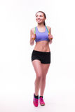 Young fitness woman with healthy sporty figure with skipping rope Stock Photography