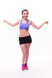 Young fitness woman with healthy sporty figure with skipping rope Stock Photos