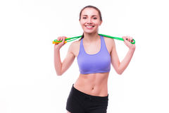 Young fitness woman with healthy sporty figure with skipping rope Stock Images