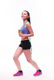 Young fitness woman with healthy sporty figure with skipping rope Royalty Free Stock Image