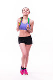 Young fitness woman with healthy sporty figure with skipping rope Royalty Free Stock Photos