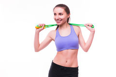 Young fitness woman with healthy sporty figure with skipping rope Royalty Free Stock Photography